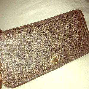 Brown Michael Kors button wallet